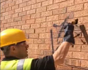 Removing graffiti from brick